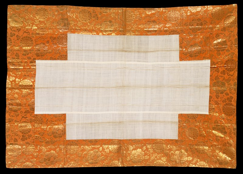 Gold floral brocade on light brown ground around border; central section and back are light tan. Woven fabric