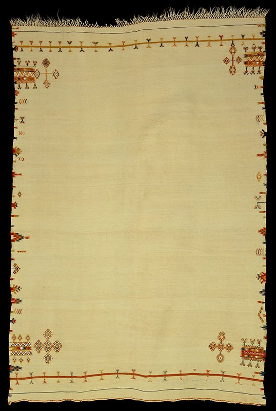 cream colored with fringe on one short side; geometric patterns along long sides in orange, white, blue and green; three stripes with geometric designs at short sides. Surface ornamentation (Needlework)