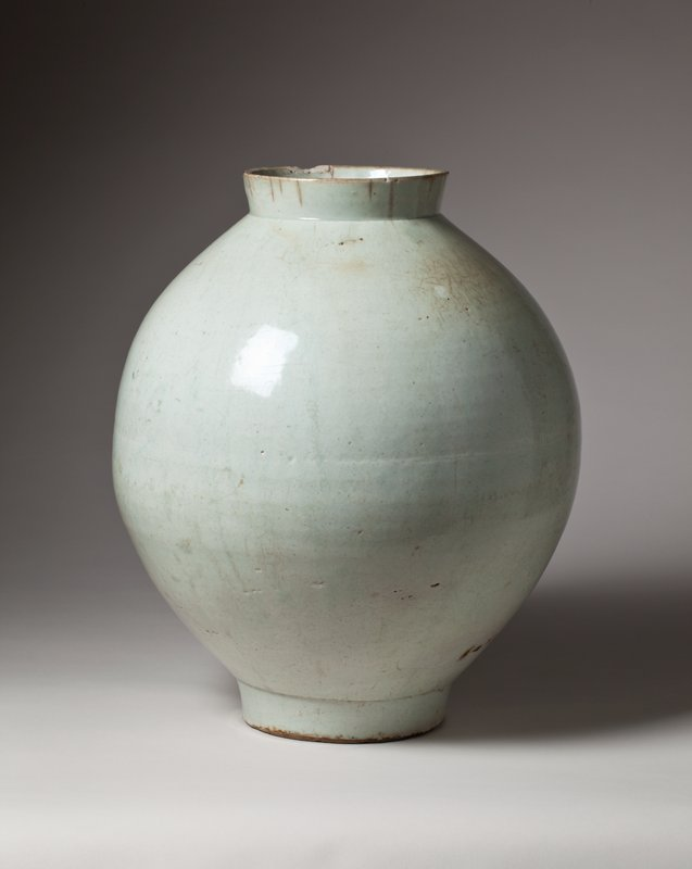 porcelain jar with small, round foot, bulbous body, short, erect, slightly outward flaring mouth; faint greenish color
