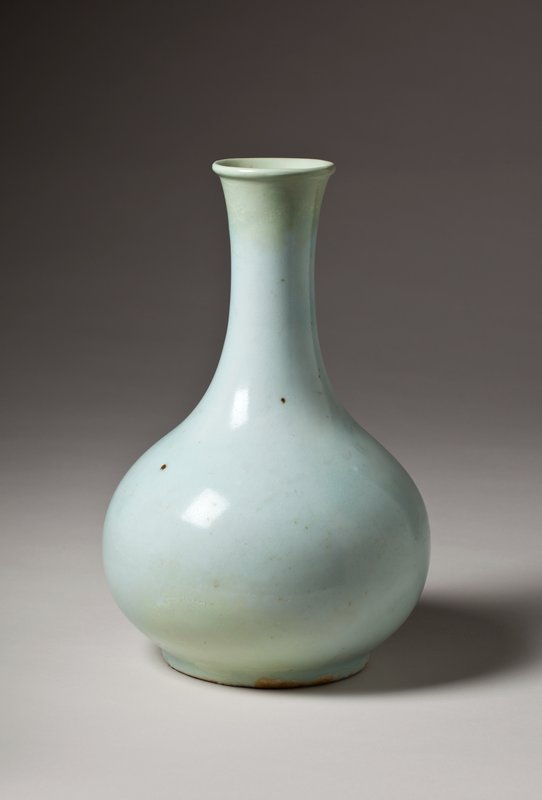 pale blue porcelain bottle with wide base, narrow, elegant neck; small, rolled lip