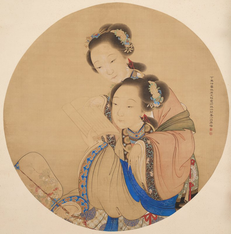 two young women reading a book; woman in front with blue trim on her garment and wearing a hoop earring with white bead drops holds book in her PL hand and holds a fan with a bamboo handle in her PR hand; woman in back with floral trim on her sleeves with brown ground and wearing a looped earring with white bead drops rests her PL arm on the shoulder of the front woman and points to the book with her PL hand; both women wear ornaments in their hair with flowers--hair ornament worn by woman in back has a dragon holding dangles in its mouth; inscription at left edge in black with two red square seals; round format