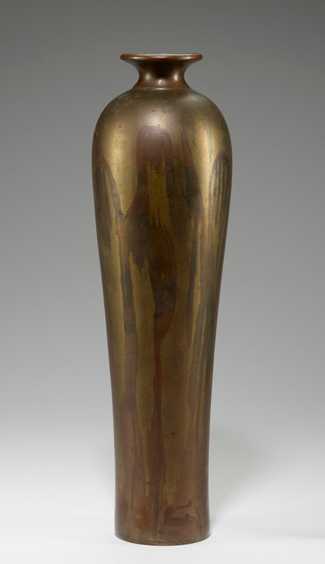 flat foot flairing very slightly outward to slightly wider shoulder; short neck with outward-flaring mouth ring; muted brass color with streaks of bronze