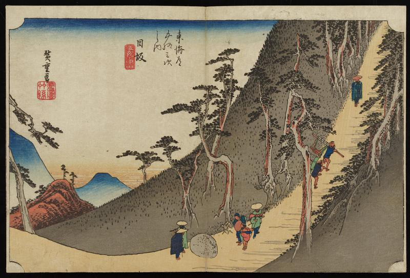 path leading down a steep slope with several travelers and hikers; bent trees; mountains in distance at L