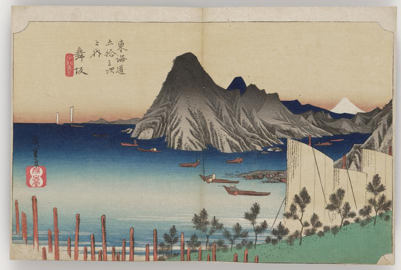 bay with several boats; black mountainous rock formation within bay at center, with white peak of Mt. Fuji appearing at UR; white rectangular masts LR along shore with small pines; pylons from mooring at L
