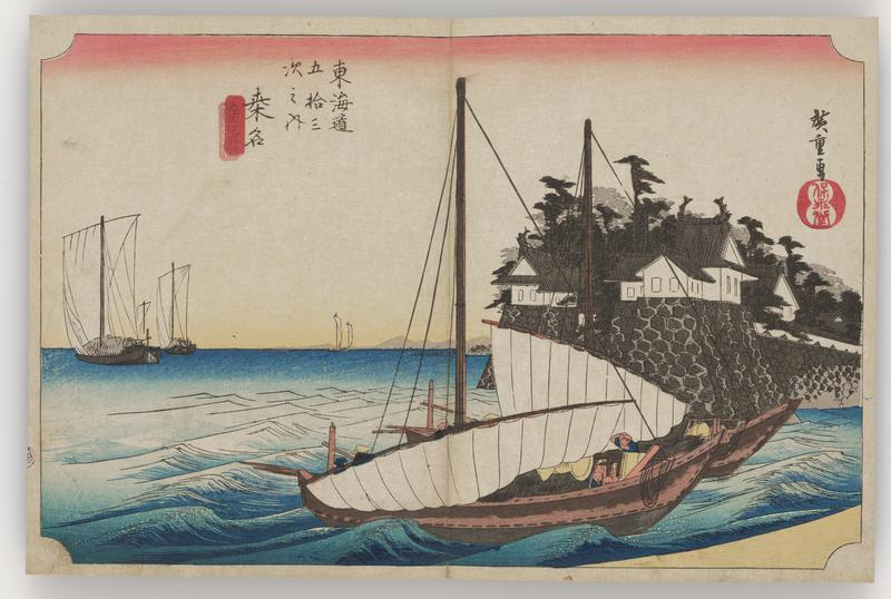 two sailboats with lowered sails crossing a choppy channel in front of a castle; other sailboats with raised masts in background at L