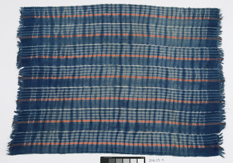 woven panel with blue background; horizontal thin white stripes alternate orange stripes; two ends are fringed; seven strips stitched together to form panel