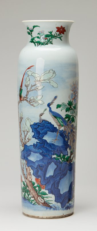 beaker shaped vase decorations in 5 colors on white ground show peacock, phoenix and smaller birds among rocks with begonia tree and peony blossoms; from Davies Collection.