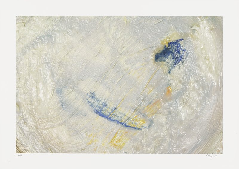 abstract image; cream-colored and gray pigments resembling brush strokes; blue and yellow, streaky sections in lower center and upper right quadrant