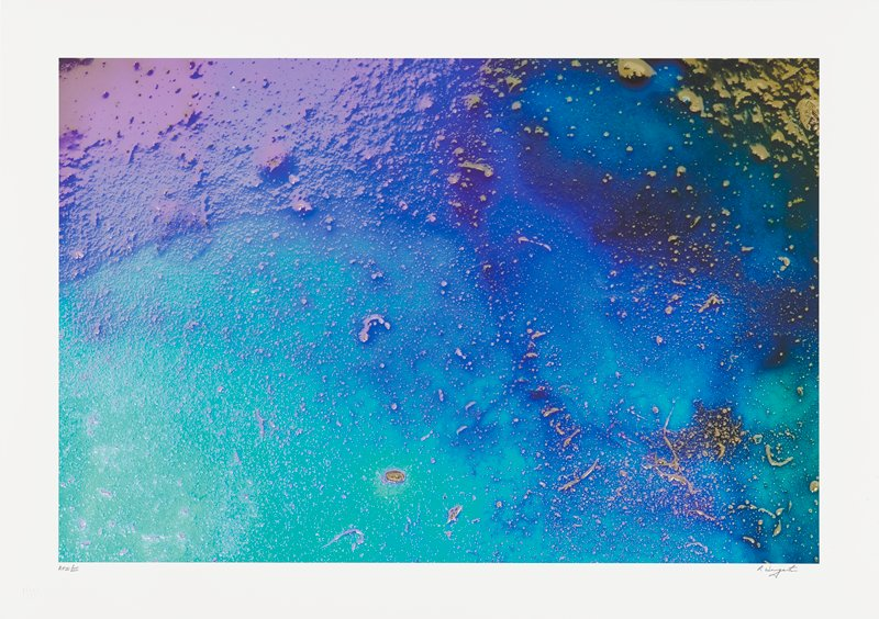 abstract image; lavender, sea green, blue, turquoise and black pigments; gold splatters along right half