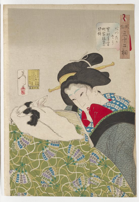 woman reading a book, propped against object covered in green fabric with multicolored floral fan patterns, with a black and white cat lying on top of it; woman wears a gray and blue kimono with black collar, with floral rondels, with collar of blue with white flower and bird pattern and red undergarment