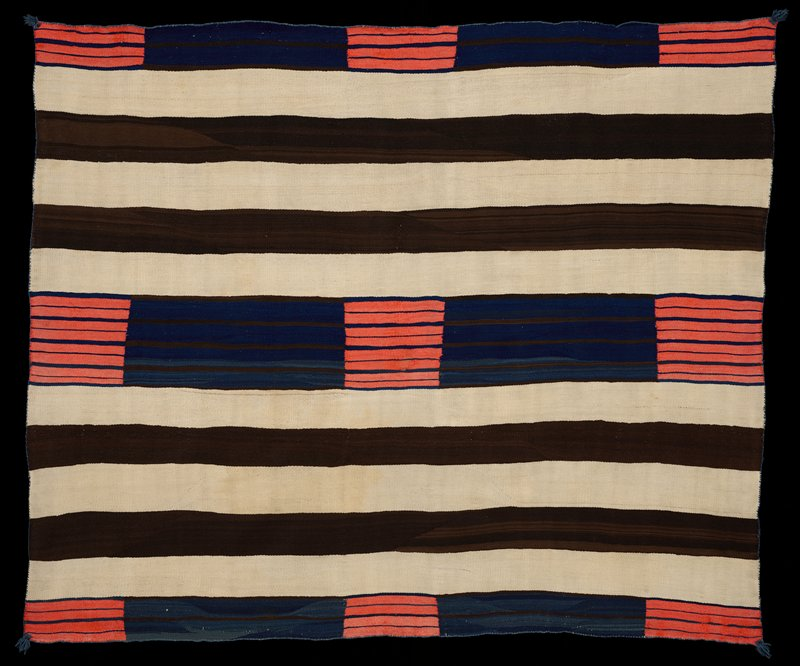 horizontal bands of black and white; central band of navy blue punctuated with coral blocks; similar navy blue and coral bands across top and bottom edges; has heading band