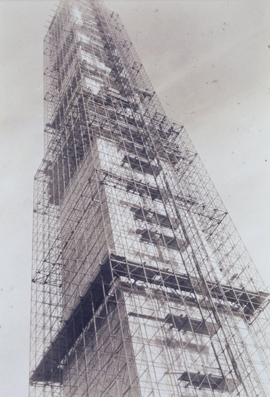 view to top of the Washington Monument covered with scaffolding