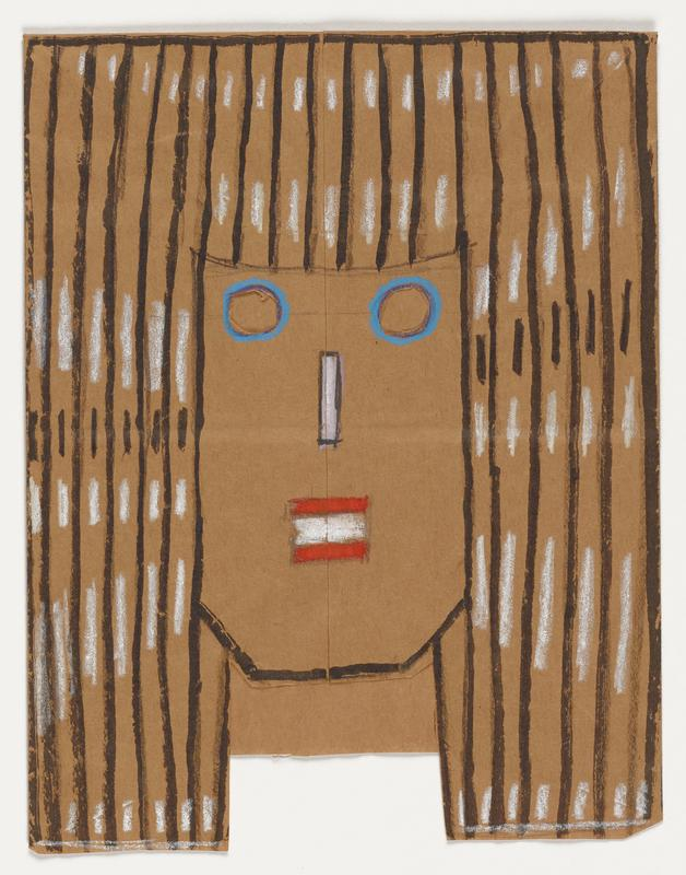 folded rectangular bottomed brown paper bag cut and drawn to form a fact with a squared-off jawline and long striped black-and-white hair; round cut out eye holes rimmed in blue; white rectangular nose; red horizontal rectangles flanking white rectangle for mouth