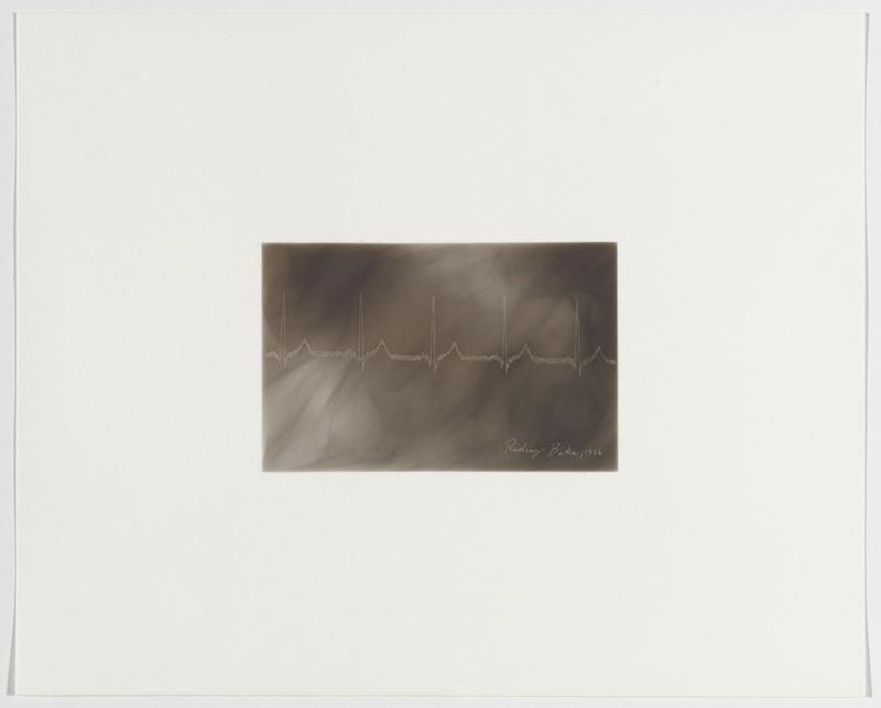 smoky grey background; thick white line with small regular peaking zigzags alternating with tall, narrow peaks