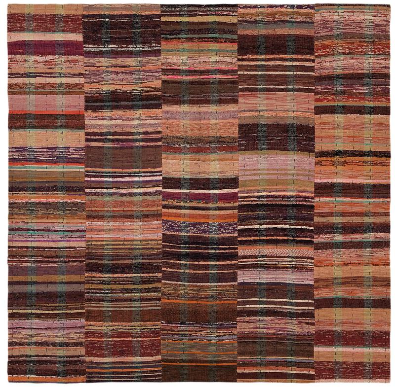 five panels woven with red warp; colors range from light blue, red, purple, teal, to gray and black; lined on back with navy fabric with yellow, green, and brown thin stripes; strip of tan Velcro (loop) along top edge on verso