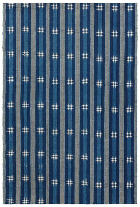 three vertical panels of blue striped fabric with orange accent stripes and white hash mark pattern throughout; strip of black Velcro (loop) along top edge on verso