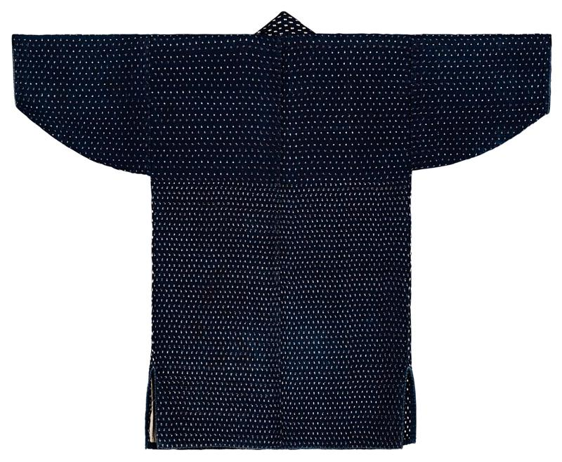 navy blue, half sleeve jacket with off white pattern throughout; sleeves and shoulders have slightly more subdued pattern; tan and blue interior with black and tan lining at bottom of backside