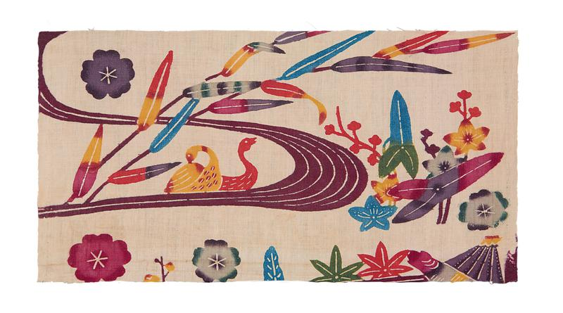 rectangular fragment of white fabric with river scene and floral designs; pink river curves through L and C with two ducks at C; multicolored bamboo leaves and flowers line the river bank and are scattered throughout