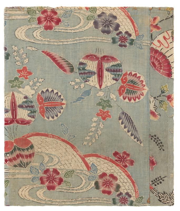two panels of patterned fabric with light blue background; floral, leaf, and wave imagery in red, blue, green, purple, and white with black accents