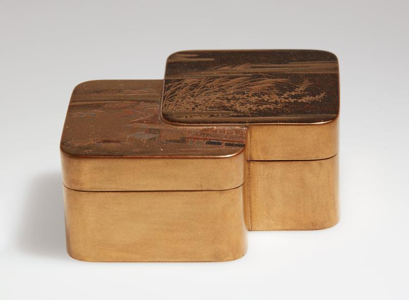 small box; top has two overlapping squares with rounded corners--top square with grasses and flowers against dark ground with clouds, bottom square with building, tree, rocks, and clouds; gold and amber; gold exterior; gold flecked amber interior and bottom; unsigned