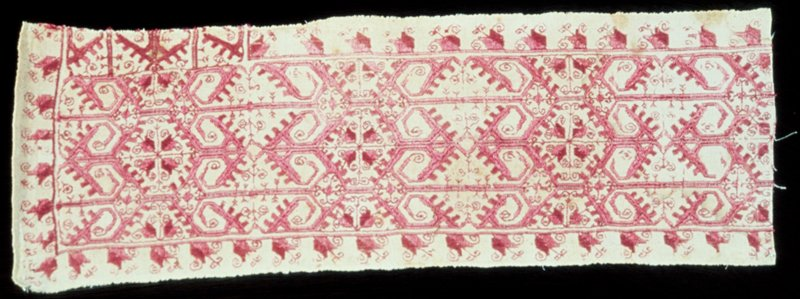 A border of white linen in punto reale and half stitch. (Germans call this Holbein stitch) with rose colored silk in ornato and geometrical forms.