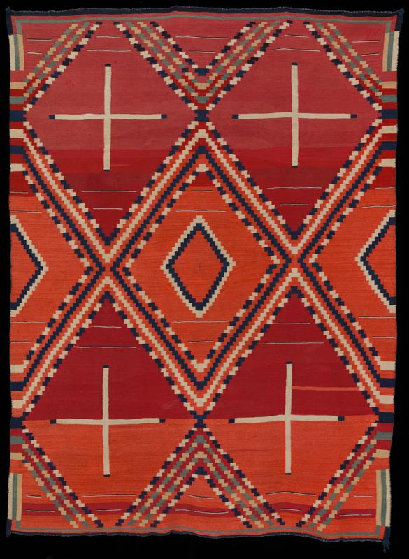 red textile with blue, green, tan, and while woven pattern; pattern consists of four white crosses with blue tips in corners, surrounded by stepped blue/white and green/tan diamond borders with a blue/white diamond outlined at center; red background is actually various shades of red, with more muted pink-red at top, bolder, orange-reds at center and bottom; navy blue border; small opening in center (incorporated into weaving)