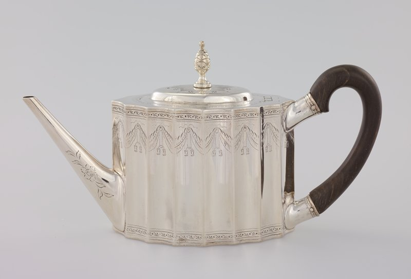 Coin silver tea service, Federal Style, consisting of teapot and lid, stand for teapot, tea caddy with hinged lid, fitted with lock and key, stand for teacaddy, covered sugar urn, cream pitcher, shell-shaped tea scoop, tea or punch strainer, pair of sugar tongs with shell-shaped ends; fluted design with engraved and pricked swags and medallions containing the monogram of John and Mehitable Templeman and all bearing Revere hall mark; teaspoons
