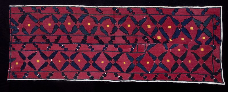 Panel; composed of two borders sewn together. The linen ground fabric is entirely covered with silk embroidery of leaf designs in green on a red ground. Embroidery.