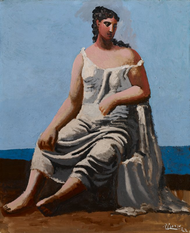 Woman in a white gown seated next to the sea. Picasso's Classical period.