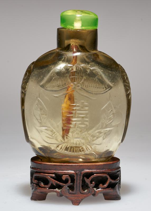 crystal with glass top; carved on the outside with bat and good luck characters