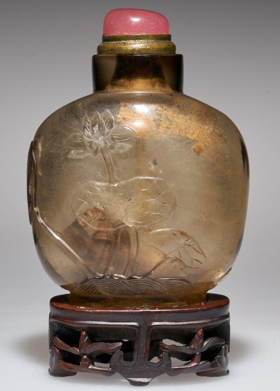 Snuff bottle. Topaz Crystal. Pink glass top. Carved lotus design.