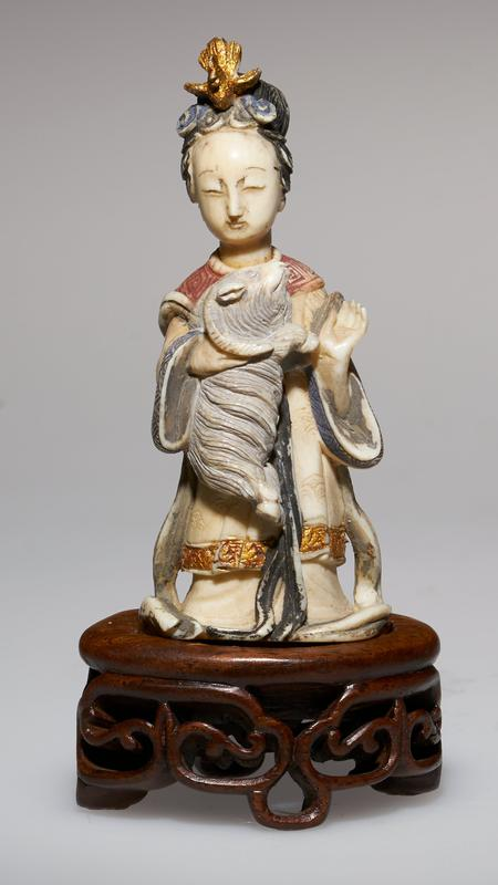 carved figure of a Princess, carrying a Ram