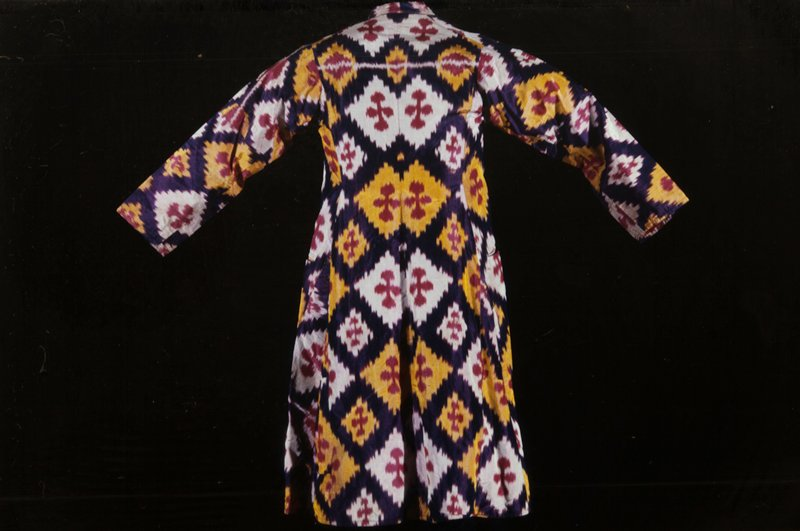 Coat of watered Andedjan silk; red shot pattern; lined with Turkey red. Silk.