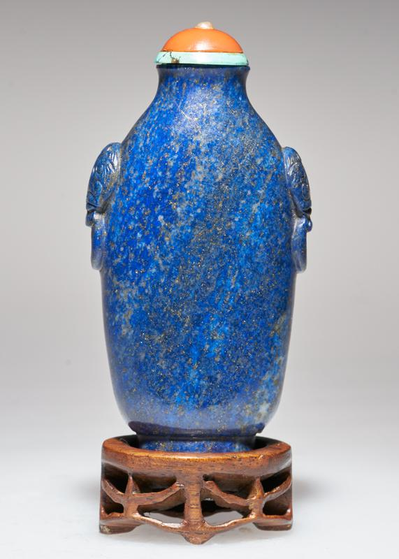 Snuff bottle. Lapis lazuli. Pink coral top. Carved.