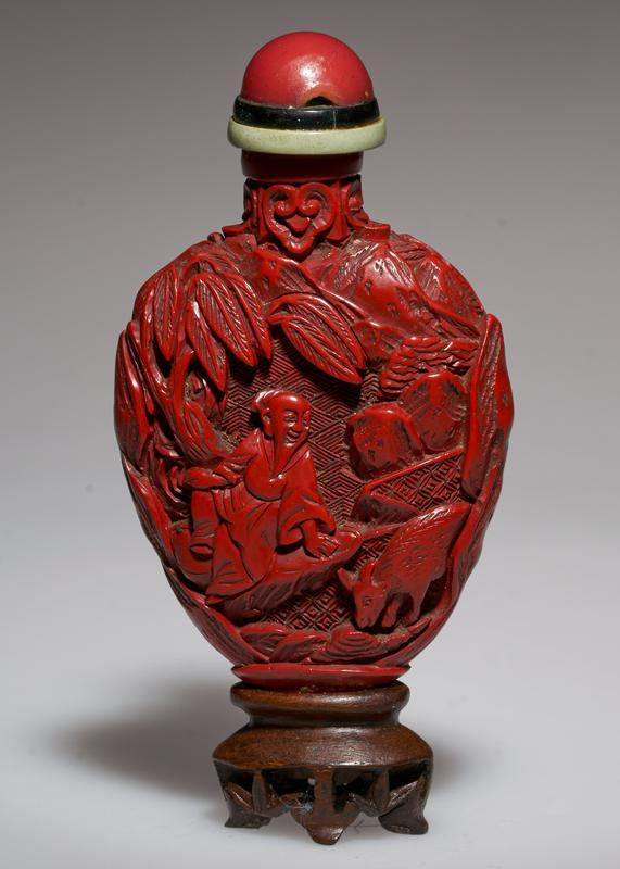 cinnabar lacquer, green glass top, carved; figure under the pine tree playing game; philosopher with Sacred Cow