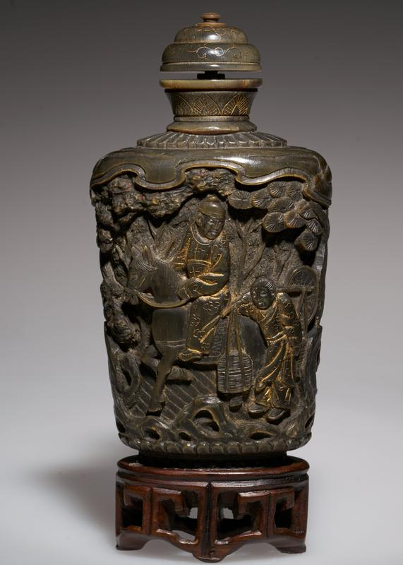 horn, deeply carved; horn top; four figures, one on horse, outlined with gold