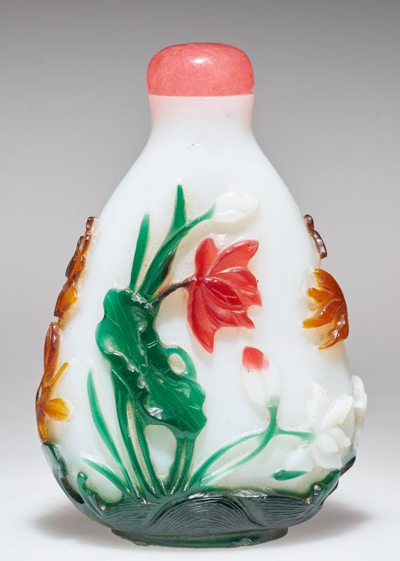 pink glass top; flowers and fish carved in five colors on white glass