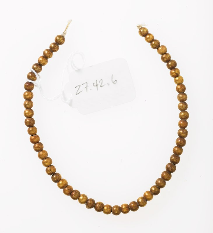 string of small spherical beads, gold