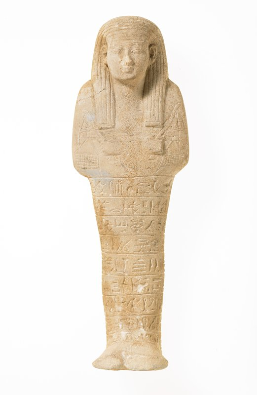 Ushabati holding hoe in each hand, yoke laid across hands, basket for grain hanging at each end of yoke. Inscription in horizontal rows. 'To illuminate the Osiris Rames'(Ramses?) He says Ushabati - - 'The conventional formula, well cut. A very good Ushabati, probably of XVIII or XIX Dynasty. 'RA-MOSE' H. 10-1/4 in. carries two hoes and bar with bags of grain He does farm work for death.