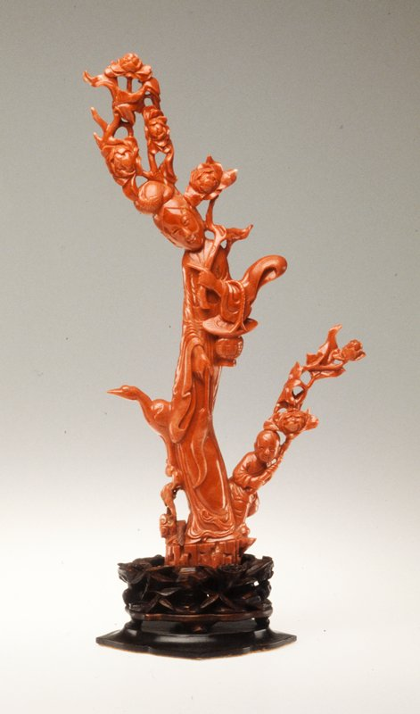 Statue of the Taoist divinity Hsi Wang Mu, red coral; carved wood base.