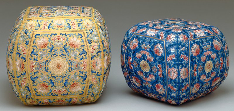Elbow Pillow; blue silk with yellow and rose embroidery.