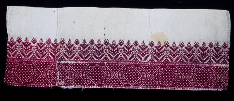 pillow border, embroidered in red silk diagonal and straight stitch on tan linen; conventional shrub and tree design with the supplementary border in lozenge design; in three pieces seamed together