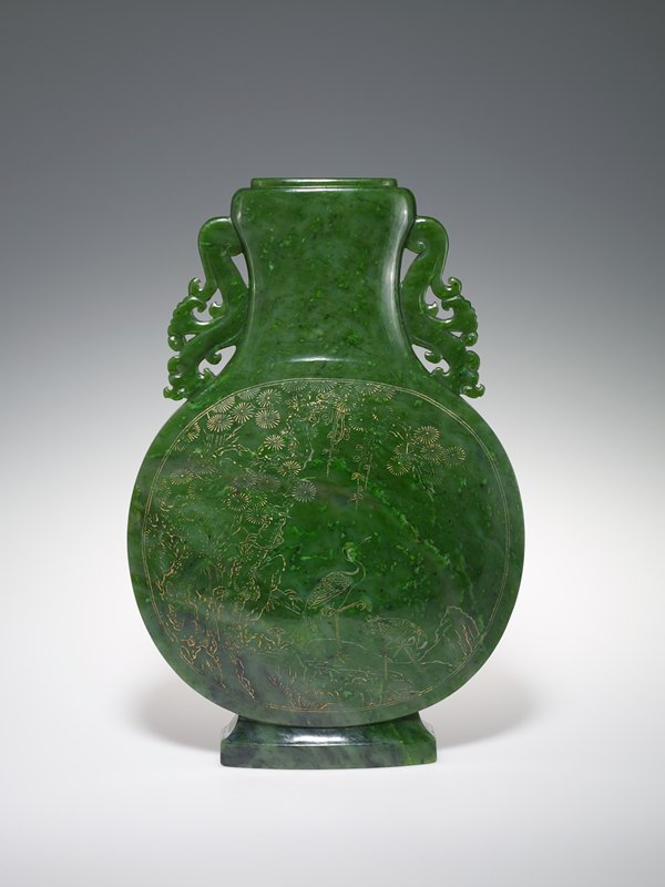 emerald green jade, of exceptional size and quality; design etched with gold; rare begonia leaf marking.