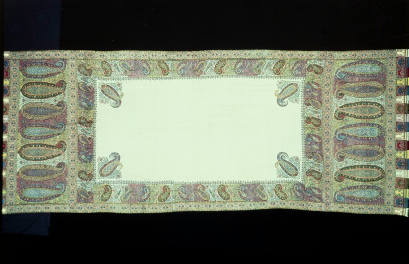 Doshalla, or long shawl, hand-loom woven in one piece. White field with end cones woven in colors. The corner ornaments are embroidered in darn stitch. Lining of tan sateen. This type of long shawl is called 'shapasand' #7 in exhibition.
