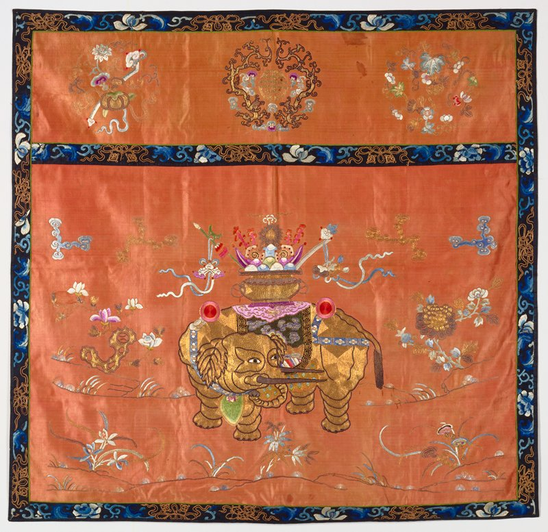 Altar frontal of faded coral satin embroidered with a large elephant, clouds and sprays of floweres in colored silks and couched gold threads; elephant partially worked with peacock feathers. Valance section embroidered with three medallions containing good luck symbols and characters, and flowers. Gold thread and colored silks in couched and satin stitch. Borders of black satin embroidered with flowers in shades of blue, and symbols in couched gold threads. Lining of pink cotton.