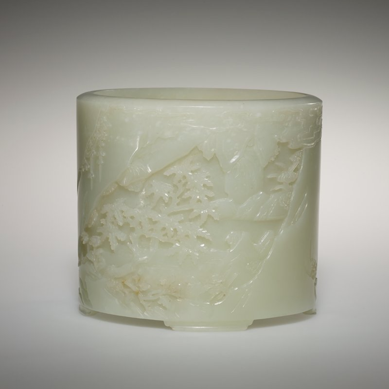 Brush holder, white jade carved with design of landscape showing mountain rocks, flowers and Ling-Chih, the plant of Long Life.