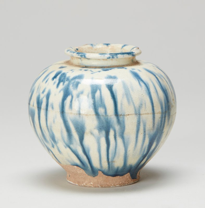 Spherical; white earthenware ground with dark blue glaze mottled.