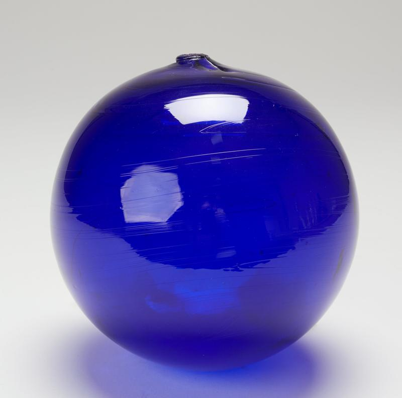 ball, blue colored glass; measured on stand (should it be numbered'b'?) cat. card dims H 6 x diam 6'