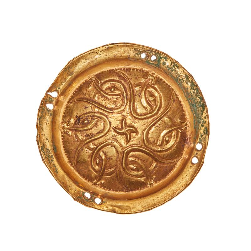 Created in Jincun; one of a pair of ornaments, round, animal style, interlaced serpents or hydra around central star-like form, bead pattern with simulated granulation; repousse, gold.