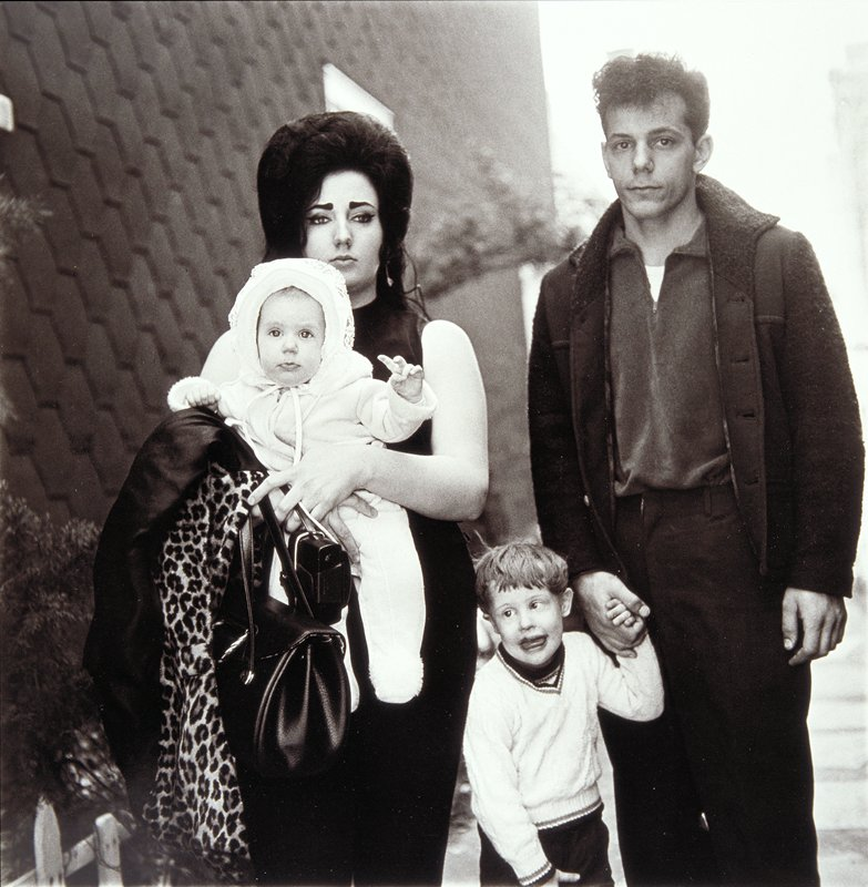 a young family in brooklyn going for a sunday outing their baby is